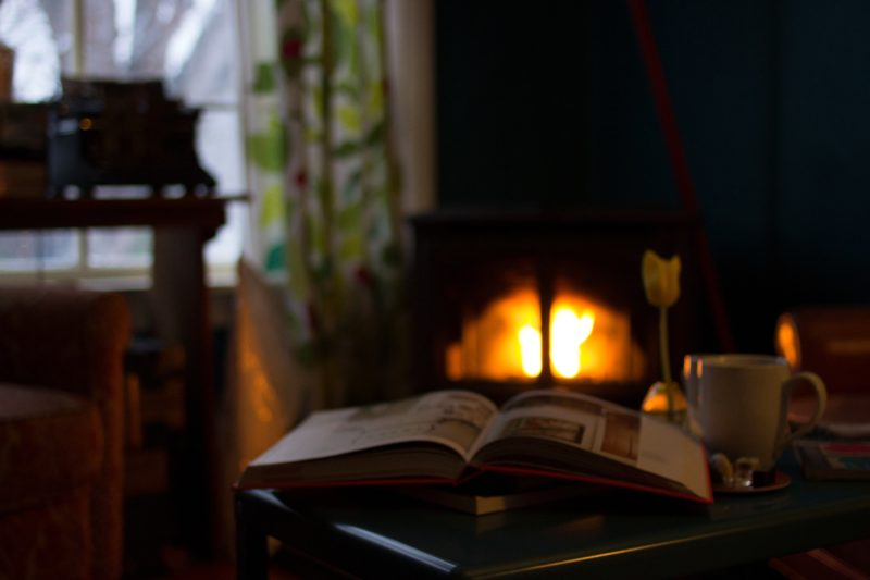 warm cottage with fireplace and book